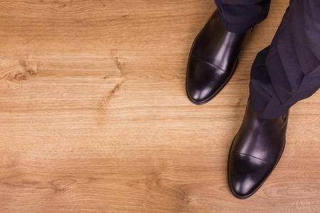 Businessman standing on the floor in polished shoes photo