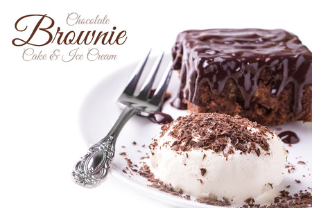 A dish of brownies and a ice cream and dessert fork on white background photo