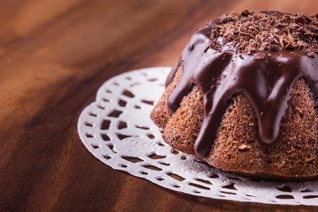 Fudge brownies served on white napkin on wood table photo