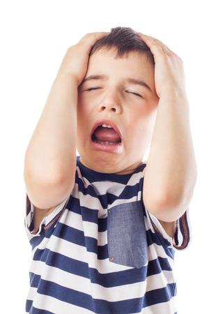 naughty boy: Naughty boy is grabbing his head and yells Stock Photo