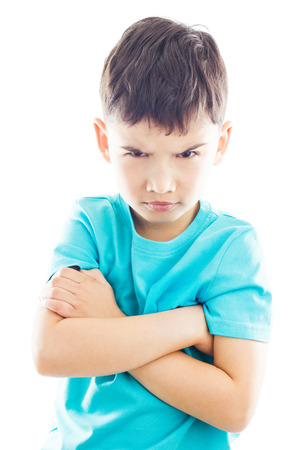 folding arms: Boy looking frown and folding ones arms