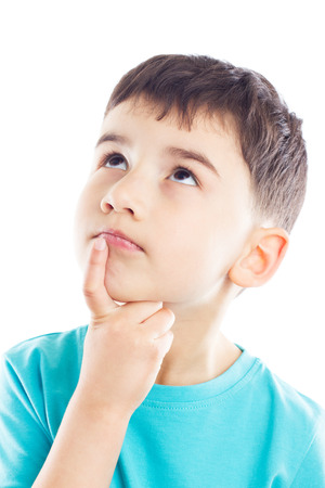 lost in thought: The boy lost in thought, looking up, his finger in chin Stock Photo