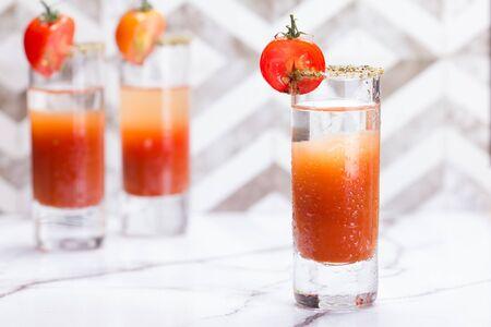 Bloody mary shots garnish with half a tomato