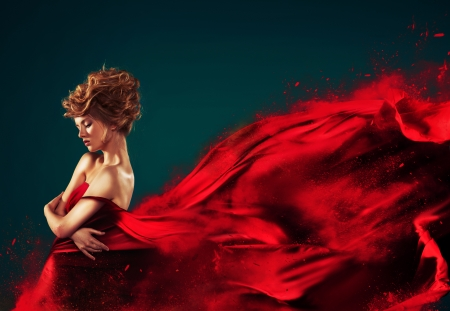 Woman in red blowing flying red dress dissolving in splash photo