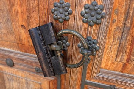 Antique lock made of steel on wooden door. Korea style. Stock Photo