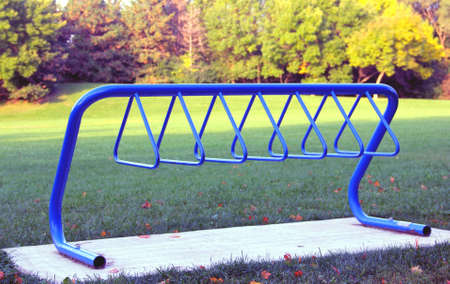 bike parking: Blue steel bicycle parking rack in the park  Stock Photo
