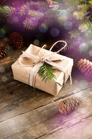 dcor: Gift cones and fir branches on wooden background Filter