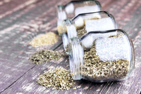 plantain herb: Glass jars with dry herb Chamomile Nettle Plantain on wooden background