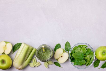 Glass Jar of Healthy Green Smoothie Detox Drink wirh Green Apple Celery and Raw Spinach Diet Beverage Copy Space