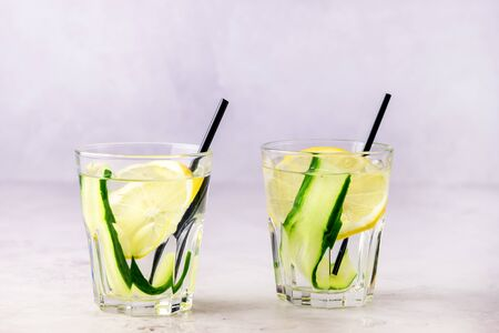 Glasses of Healthy Detox Water with Lemon and Cucumbers Diet Drink Straw Horizontal 免版税图像