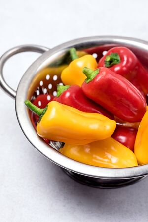 Set of Colored Bell Peppers in Bowl Ripe Peppers Gray Background Vertical Stock fotó