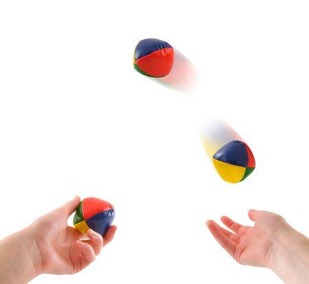 Juggling - Hands juggling three colorful balls