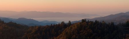 ridgeline: Sunrise Above the Clouds - panorama of the Smoky Mountains National Park.