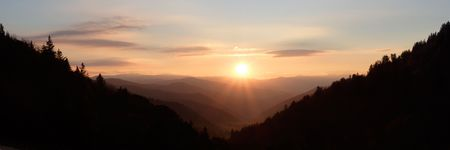 overlook: Mountain Daybreak Panorama - Sunshine beaming over a valley of the Smoky Mountains National Park, USA.