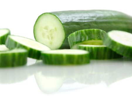 Cucumber and slices on a white background.