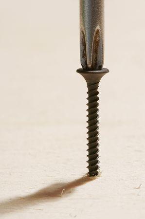 screw: Screw and Screwdriver on Wood Stock Photo