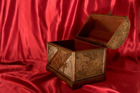 Treasure Chest on Red Satin Background, Empty