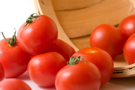 Tomatos (Campari Variety) Rolling form a Wicker Basket Stock Photo - 3178272