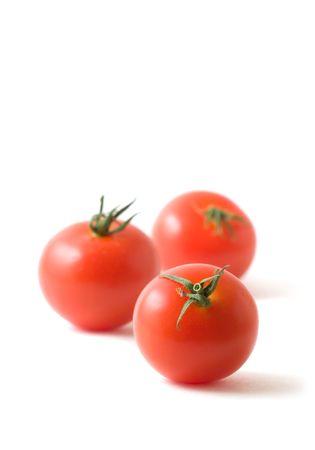 tomatos: Three Tomatos (Campari Variety) on White Stock Photo