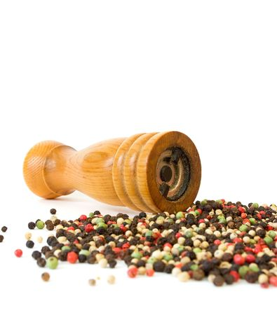 peppercorns: Pepper Mill and Peppercorns on White Stock Photo