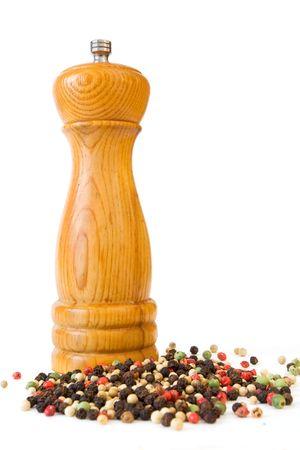 Pepper Mill and Peppercorns on White 版權商用圖片