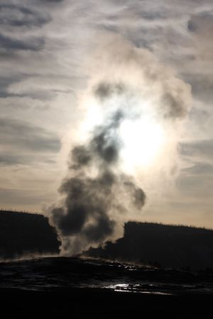the faithful: Old Faithful Geyser Sunset - Yellowstone National Park