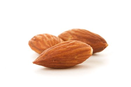 Three Almonds on a white background. photo