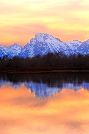 oxbow: Mountains reflecting in the Snake River at Oxbow Bend at Sunset - Grand Teton National Park, Wyoming.