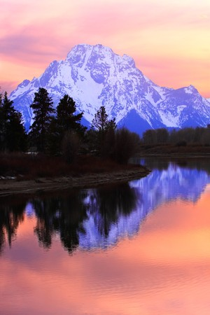 oxbow bend: Mount Moran reflecting in the Snake River at Sunset - Oxbow Bend, Grand Teton National Park, Wyoming.