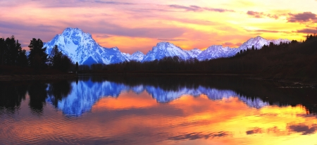 The Grand Tetons at sunset reflecting in the Snake River, from Oxbow Bend - Grand Teton National Park, Wyoming.
