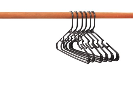 hangers: Empty Closet - Group of Hangers on a Rod, Isolated Stock Photo