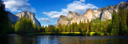 Panorama of El Capitan and the Cathedral RocksBridalviel Falls with the Merced River flowing in front.
