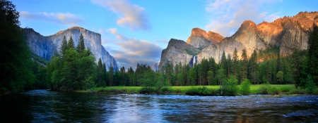 Panorama of the Yosemite Valley (El Capitan, Cathedral Rocks, Bridalviel Falls) at the Merced River.