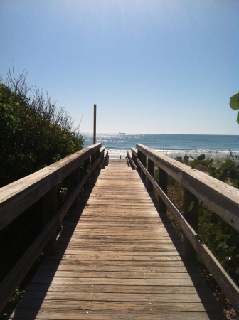 Cocoa Beach FL board walk leading from Seagull Resort to the ocean  Stock Photo