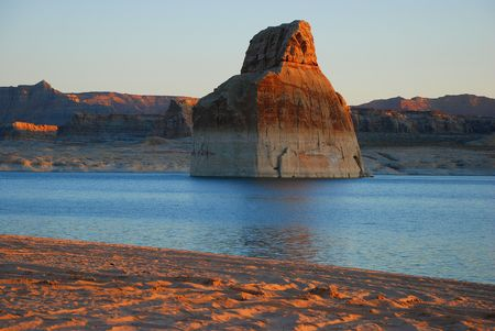 Daylight breaks on lone sandstone formation in bay Stock Photo - 3132431