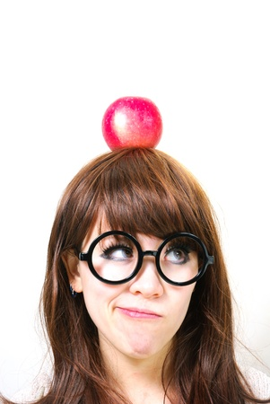 Thinking girl with apple on head Stock Photo - 12720837