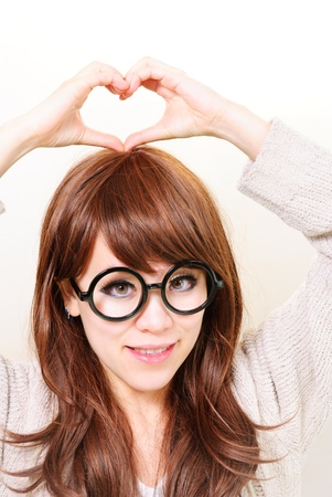 indoor young woman make heart Stock Photo - 12720794