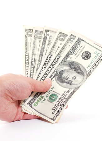 Woman hands with money on white background photo