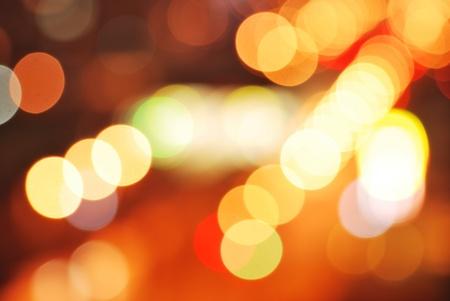 Decorative defocused winter lights. Yellow, purple, white, red color photo