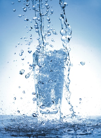Water splash out of glass photo