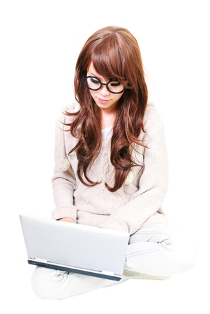 Attractive teenage girl with laptop. All on white background. Stock Photo - 13068666