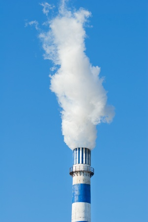 industrial smoke from chimney on blue sky Stock Photo - 13122163