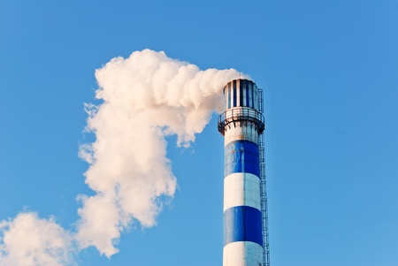 industrial smoke from chimney on blue sky Stock Photo - 13122291