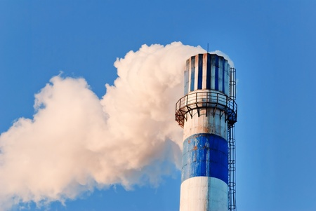 industrial smoke from chimney on blue sky Stock Photo - 13122130
