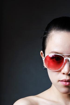 Women in shaw was wearing dark sunglasses photo