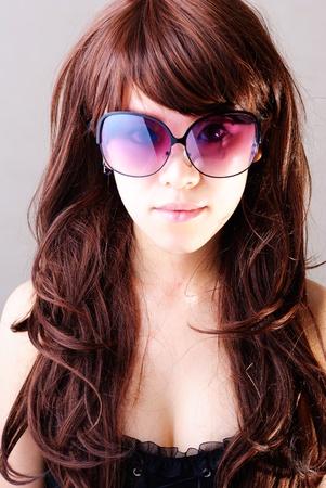 Women in shaw was wearing dark sunglasses Stock Photo - 13405940
