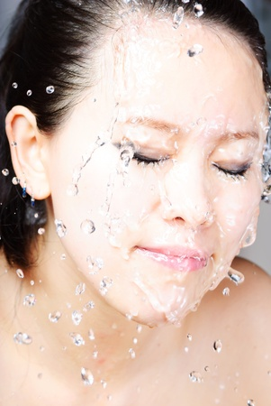 Beautiful wet woman face with water drop Stock Photo - 13405845
