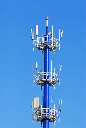 Mobile phone communication against blue sky photo