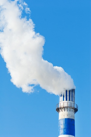 industrial smoke from chimney on blue sky Stock Photo - 13510314