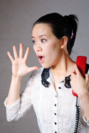 Young angry woman yelling on phone Stock Photo - 13632706